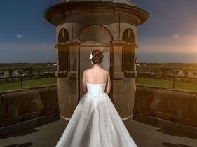 bride on roof of castle