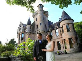 couple outside castle