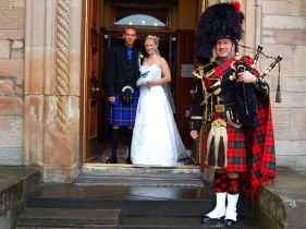 bride & groom and piper