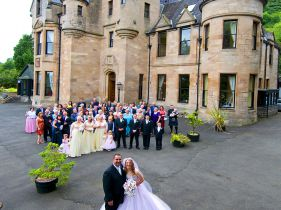 wedding party outside castle